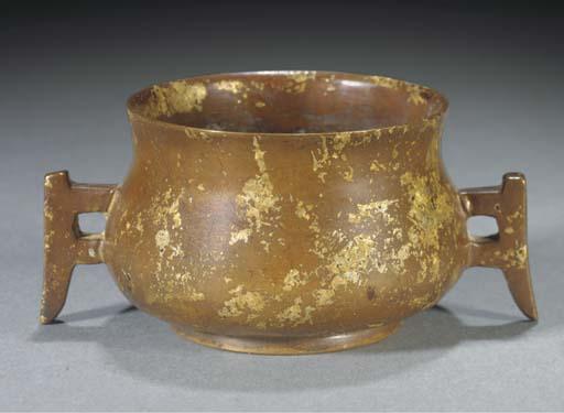 A bronze gold splashed censer,