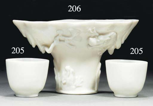 Two blanc-de-chine wine cups,