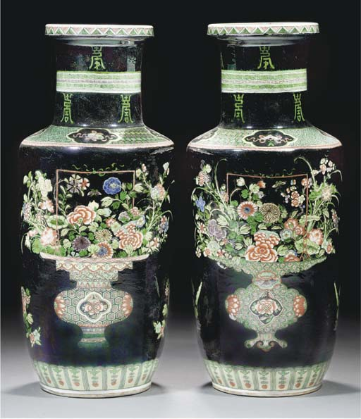A pair of famille verte noire ground rouleau vases, 19th Century