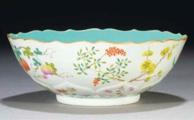 A famille rose moulded bowl, J