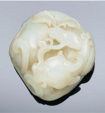 A white jade carving of a qilo