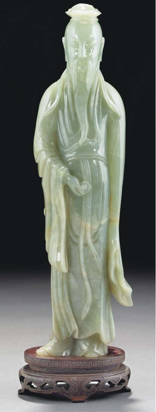 A large celadon jade figure of
