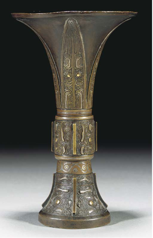 A bronze gu vase inlaid with g