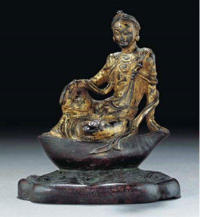 A gilt bronze model of a bodhi
