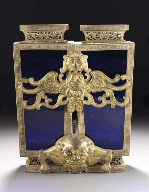 A twin sectioned blue glass and gilt bronze mounted vase, 18th century