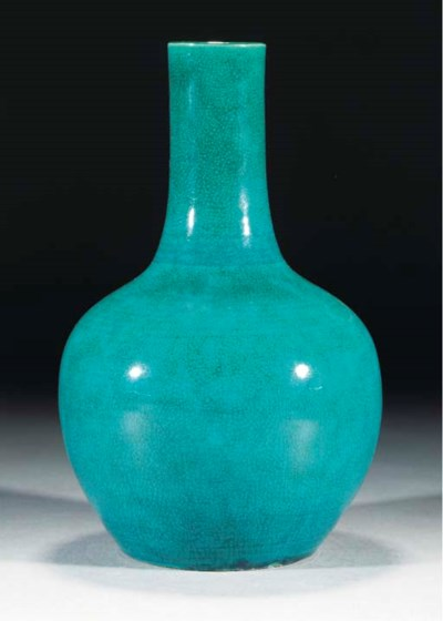 A turquoise glazed bottle vase