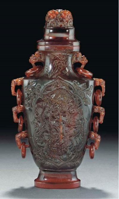 A carved amber vase and cover,