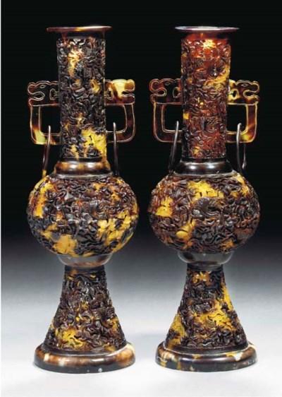A pair of tortoiseshell vases,