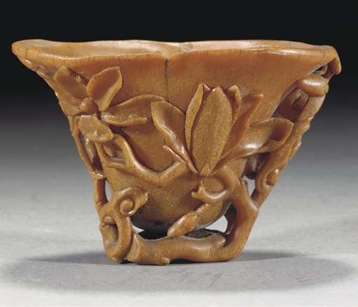 A carved rhinoceros horn libation cup, 18th Century