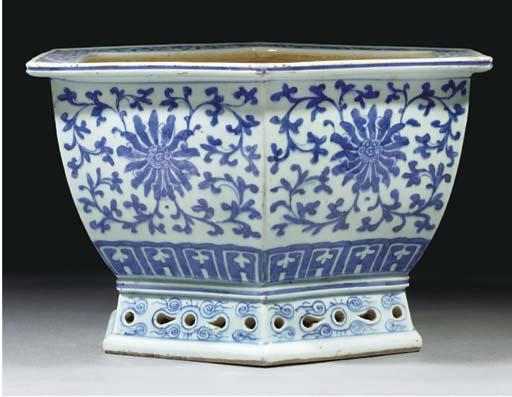 A blue and white hexagonal jar