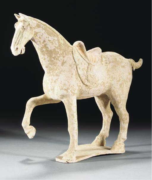 A painted pottery model of a prancing horse, Tang dynasty