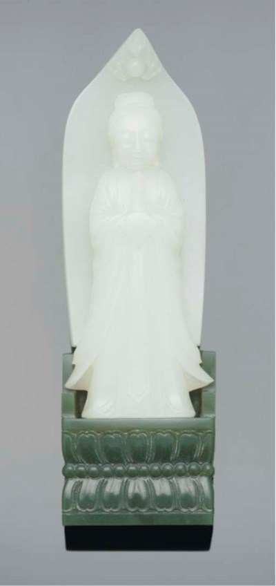 A white jade carving of an imm