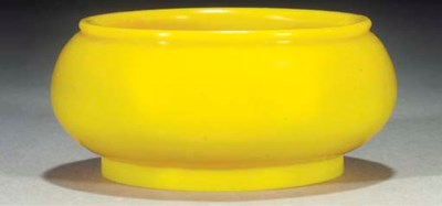 An opaque yellow glass bowl, 1
