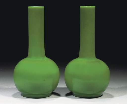 A pair of opaque green glass b