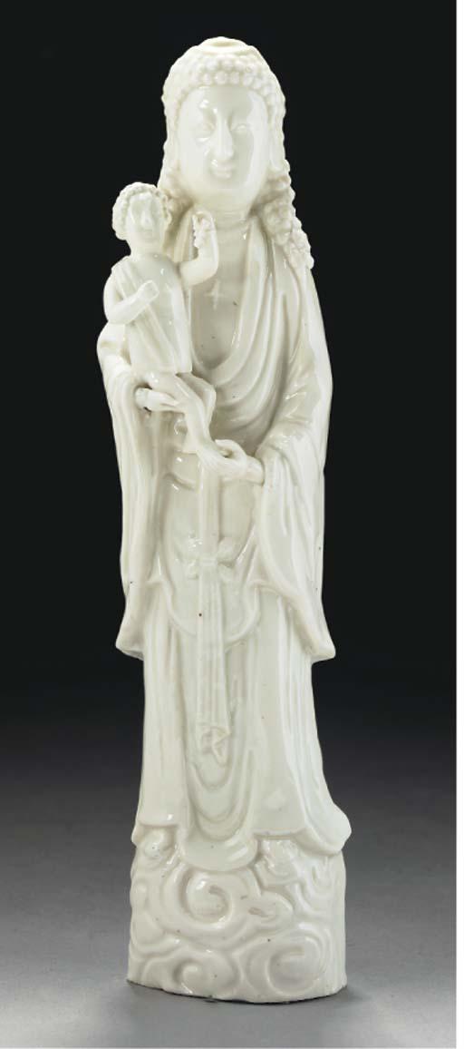 A blanc-de-chine Madonna and child group, Kangxi