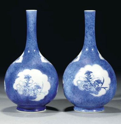 A pair of blue and white powde