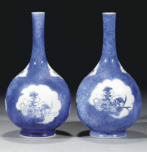 A pair of blue and white powder blue ground bottle vases, Kangxi