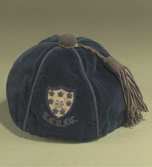 A BLUE RUGBY CAP AWARDED TO PR