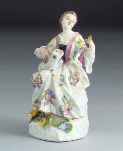 A Meissen figure of a seated l