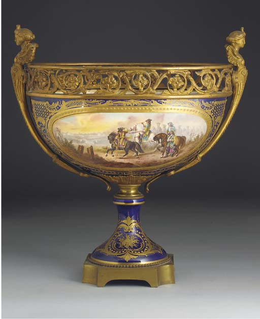 A Sevres-style oval gilt-metal