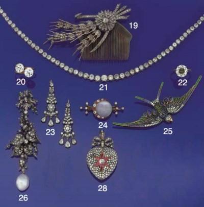 An antique diamond pendant bro