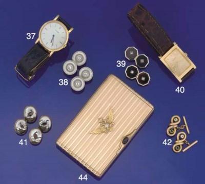 A Russian gold and gem set Cig