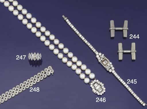 A pair of diamond cufflinks by