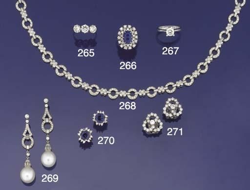 A sapphire and diamond oval cl