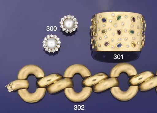 A diamond and gem bangle by Ch
