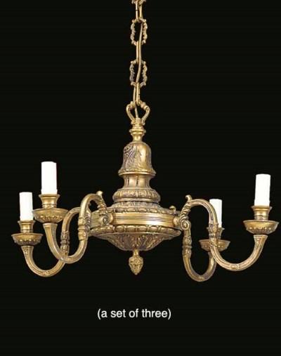 A set of three gilt metal chan