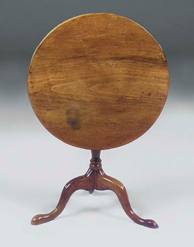 A WALNUT TRIPOD TABLE