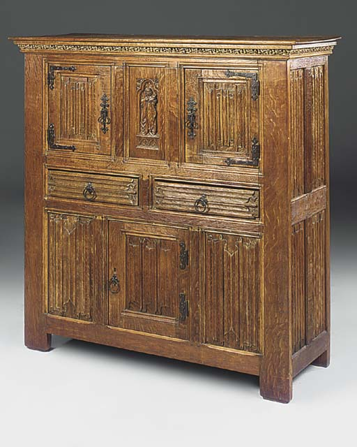 A NORTH EUROPEAN OAK CUPBOARD