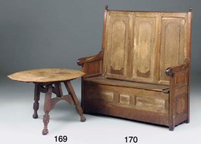 An oak panelled settle