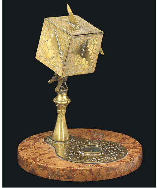A reproduction brass cube dial