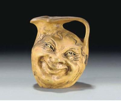 A Stoneware Double Faced Jug