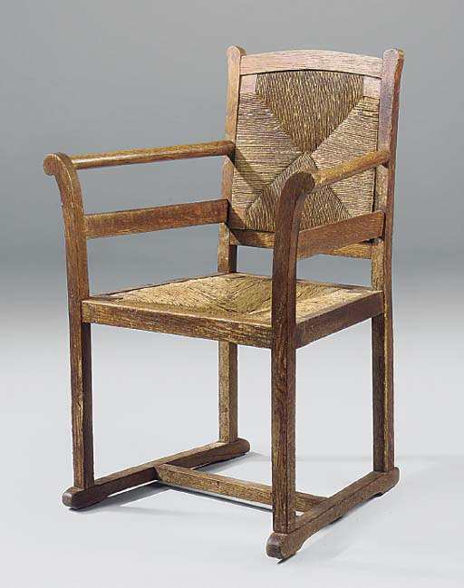 AN OAK OPEN ARMCHAIR