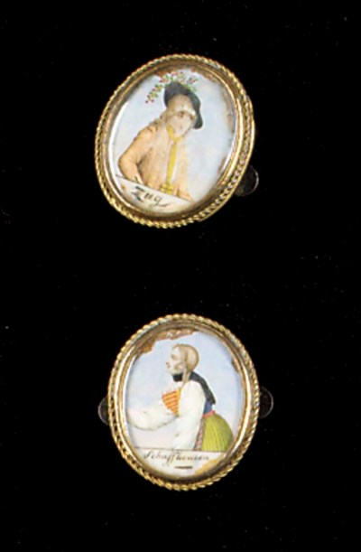 A pair of oval glazed gilt met