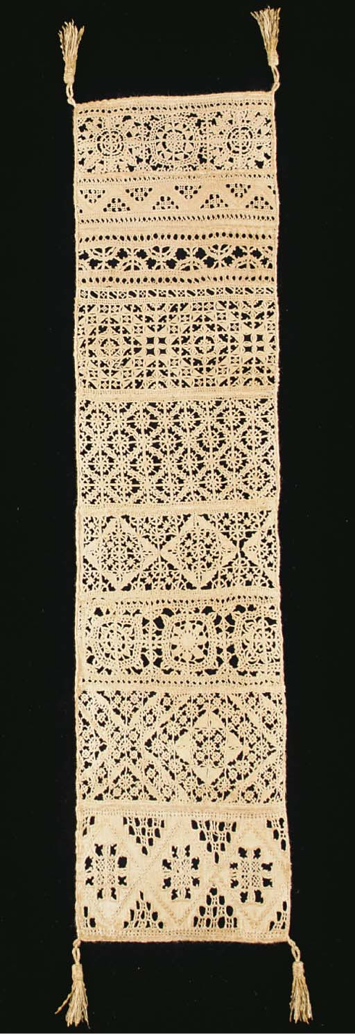 A fine needlelace linen sampler, comprising a series of cutwork and Reticella bands, with tassels to each corner --28½ x 7 in. (73 x 18cm.), Italian, mid 16th century