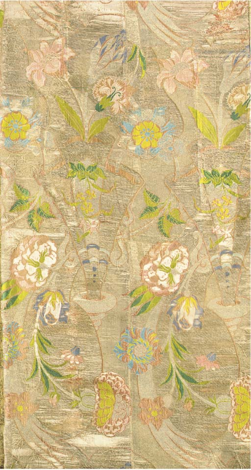 A brocade cover, woven in colo