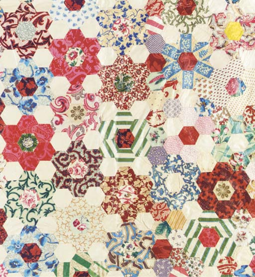 A quilted patchwork coverlet,