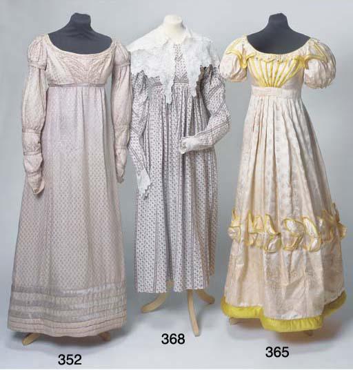 A lady's dress of pale apricot