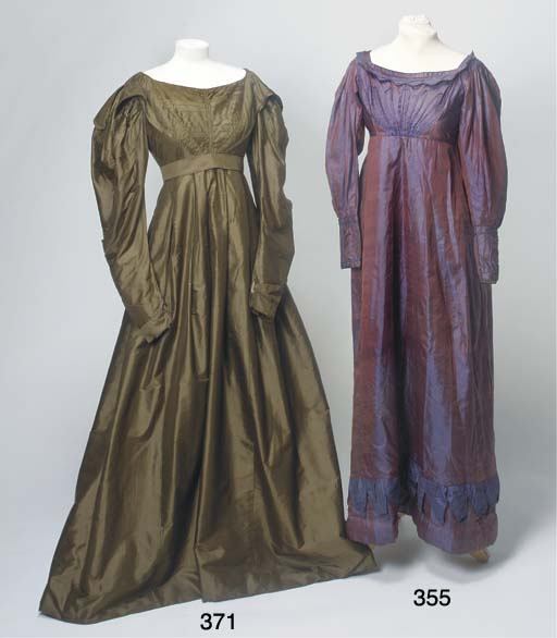 A lady's day dress of sage green silk, the high waisted bodice with pin-tucks and self-fabric panels from shoulders to waist-line, forming collar, lined with bottle green silk, with gigot sleeves, full skirt with padding to hem-line, lined with linen and glazed linen and matching belt, underarm staining and some damages, circa 1830