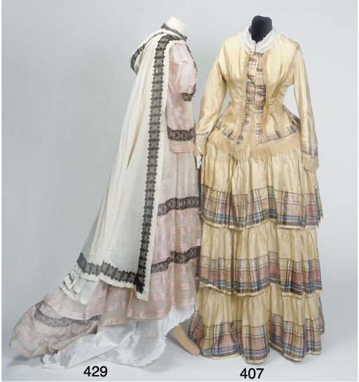 A lady's dress of pink and ivo
