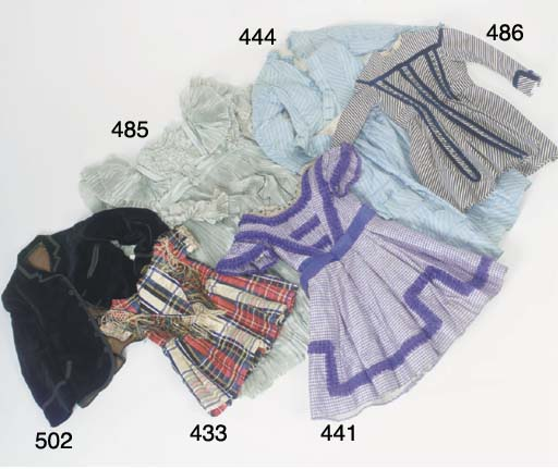A young girl's dress of navy a