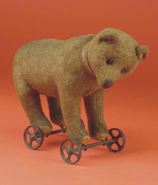 An early Steiff bear on wheels