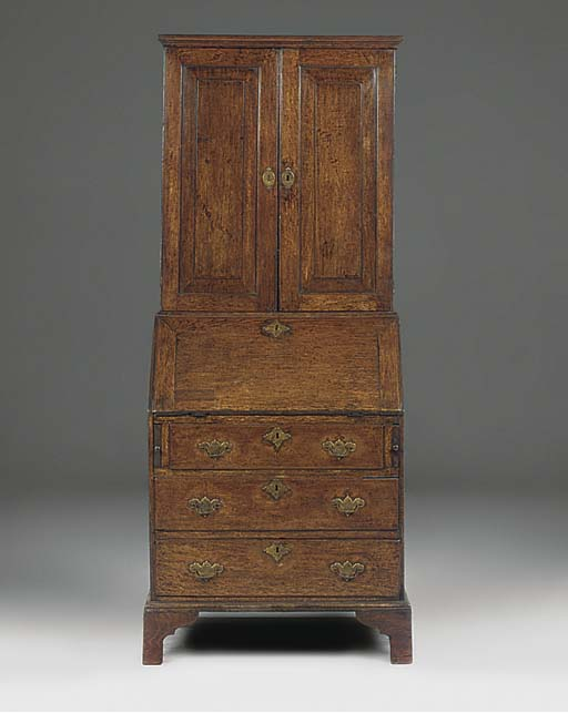 AN ENGLISH OAK BUREAU CABINET