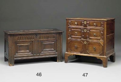 AN ENGLISH WALNUT CHEST OF DRA