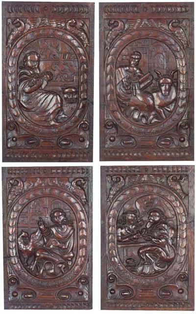 A set of four German oak relie