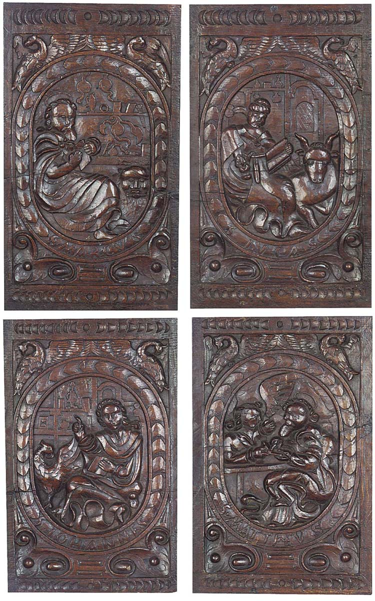 A set of four German oak relief panels of Evangelists