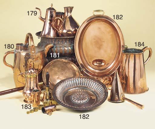 An Italian repoussé copper jar